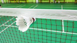 Badminton net on a badminton court with a badminton shuttlecock