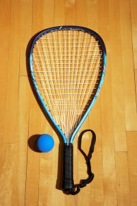 racquetball racket on a racquetball court